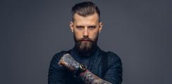 Darf ein Arbeitgeber verbieten, dass Angestellte Bart tragen?